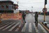 TNI-Polri di Mimika tertibkan pengguna jalan untuk mencegah COVID-19