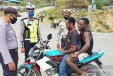 Satlantas Tolikara tegur 50 pengendara sepeda motor tanpa gunakan masker