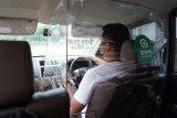 Armada GoCar saat normal baru pakai sekat pelindung antara pengemudi dan penumpang