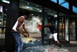 Aksi protes kematian George Floyd berujung penjarahan toko Apple