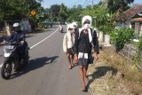 Warga Badui Dalam berjalan kaki puluhan kilometer demi silaturahim perayaan Seba