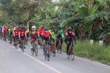 Danrem 174 Merauke sosialisasi normal baru dengan olahraga road bike komunitas sepeda