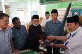 Anggota DPRD Sumbar serahkan satu unit bus untuk Muhammadiyah Agam