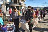 Sambut Hari Pancasila, Polsek Pekat bakti sosial di Pasar Senin