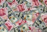 Yuan melemah 74 basis poin menjadi 6,9969 terhadap dolar AS