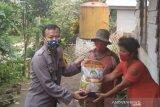 Polres Minahasa Tenggara bantu bahan pangan bagi warga transmigrasi