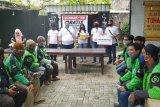 Lembaga Palu Bersatu Bangkit bagi nasi bungkus ke pengemudi ojol