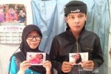 Keluarga TKI asal Cianjur berharap kepastian penyebab kematian Evi Noviyanti