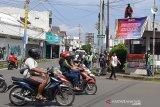 Polresta Banyumas - komunitas ojol dirikan Poskamling Jalan Raya