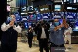 Wall Street naik setelah Fed janjikan banyak dukungan ekonomi