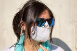 Tips aman kenakan masker di cuaca panas