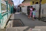 Pindahkan makam di atas jalan umum, keluarga beri tiga syarat