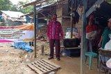 Jelang Harganas Ke-27, BKKBN Sultra berbagi sembako di kampung pemulung