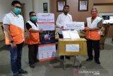 WVI kembali serahkan ratusan paket APD kepada gugus tugas COVID-19 di Touna