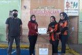 PPT RBBE salurkan APD ke pemuda pancasila Sijunjung