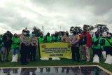 Mabes Polri bantu beras 100 lebih ojek dan sopir di Merauke