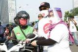KPK bagikan masker kain kepada warga kampanyekan