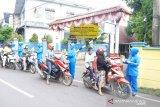 Korcab VI DJA II bagikan masker batik dan parsel sayur di Paotere