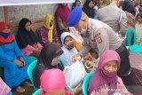 Polda Polda Sultra bagi ribuan paket sembako sambut HUT Bhayangkara
