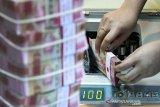 Nilai tukar rupiah menguat tipis jelang hasil pertemuan The Fed