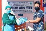Lembaga Multimedia Betang Harati bagikan masker di puskesmas