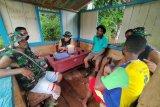 Satgas TMMD lakukan komunikasi sosial dengan warga kampung Natabui
