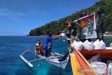 Kodim 1301 Sangihe bagikan 120 paket bantuan di Kepulauan Nusa Tabukan