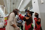 Pocil sosialisasikan pemakaian masker kepada anak-anak