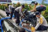 Anggota Polsek Nagan Raya Aceh modifikasi motor dinas jadi alat damkar