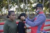 Bersepeda bersama Korem 172/PWY- BRI bagi masker gratis