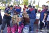 Pertamina-Hiswana Migas  salurkan bantuan logistik korban banjir Parigi