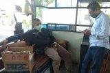 Tim tugas COVID Palangka Raya dipukul warga hingga pingsan saat bertugas