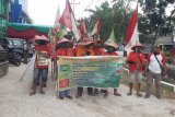 Aksi protes kelompok petani jalan kaki dari Medan ke Jakarta, sempat bermalam di Riau