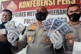 Polisi ungkap peredaran dolar AS palsu pecahan 100 dolar