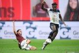 Atalanta menghentikan tren kemenangan Milan dengan paksakan hasil imbang