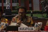 Johni Asadoma, dari bintang di ring tinju hingga bintang polisi