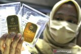 Harga emas menukik 93,4 dolar dipicu data ekonomi positif dan berita vaksin