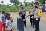 Polresta Banyumas bagikan masker dalam rangka Operasi Patuh Candi