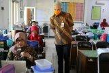 Gubernur Ganjar ingatkan penerapan protokol kesehatan saat belajar daring