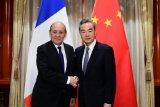 Kepada Menlu Prancis, Wang Yi nyatakan siap untuk bersikap tegas terhadap AS
