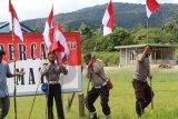 Polres Memberamo Tengah pasang bendera merah putih sambut HUT RI