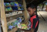 Pendeta  buat kebun baca bagi anak-anak di Kupang