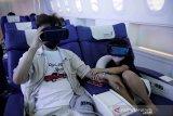 Liburan virtual dalam kabin pesawat kelas bisnis