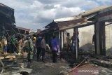Puluhan kios pakaian Pasar Griya Palembang  terbakar