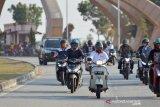 Gubri keliling Pekanbaru naik skuter tua ajak warga bermasker