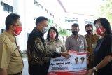 Gubernur Sulut berikan santunan jaminan kematian pekerja keagamaan