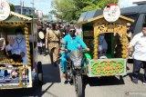 Isdianto-Suryani pakai becak motor daftar  ke KPU