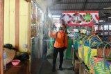 Penyemprotan Disinfektan di Pasar Induk Tanjung Selor