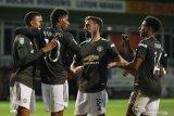 United melaju ke putaran empat berkat kemenangan 3-0 atas Luton