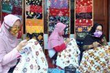 Perbedaan batik asli dengan tekstil bercorak batik